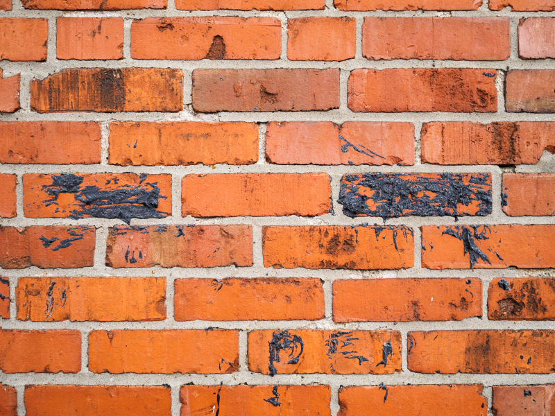 Square red orange brick wall horizontal abstract background with black tar pattern